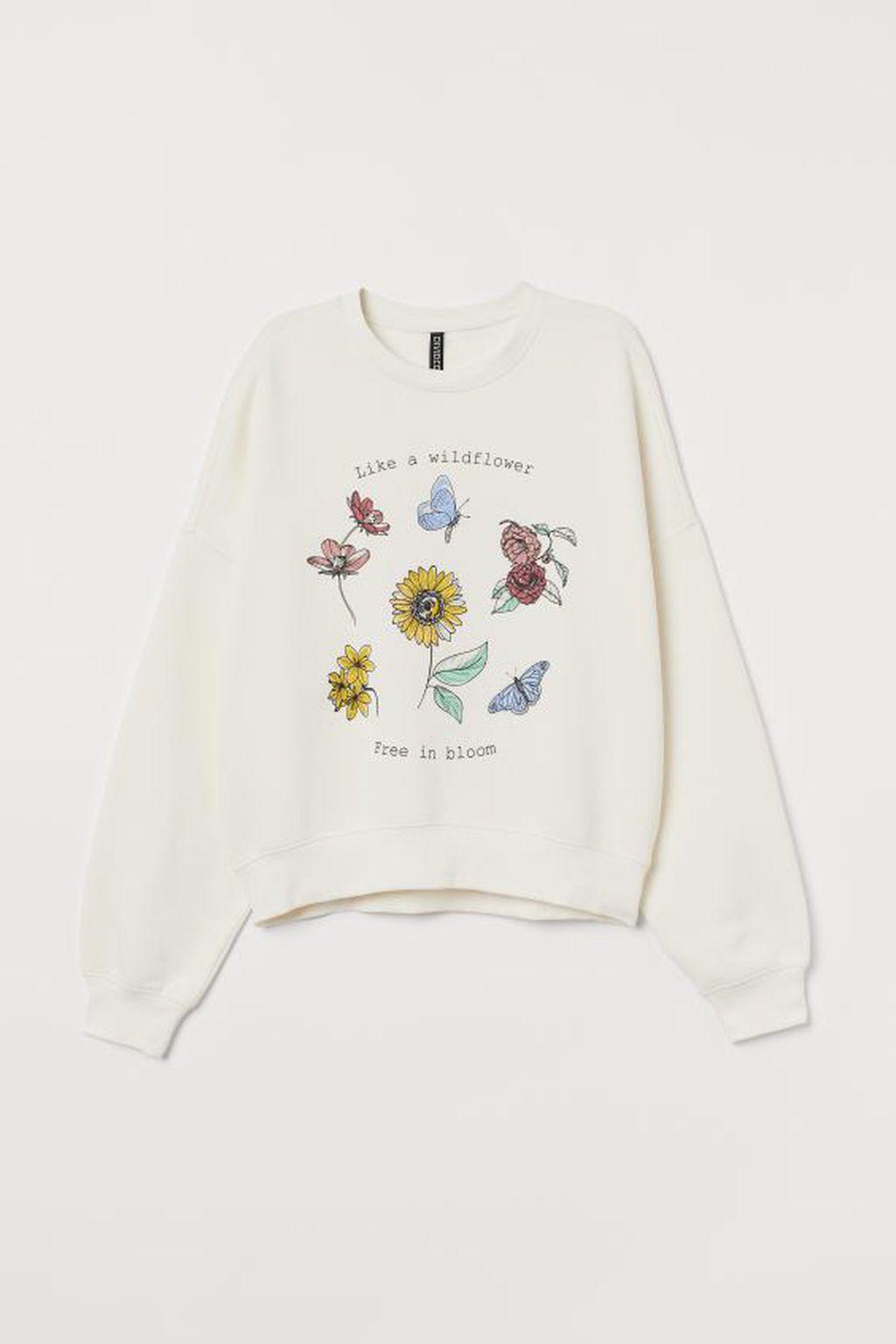 Bijela majica s cvjetnim motivima, 14.99 eura, H&M