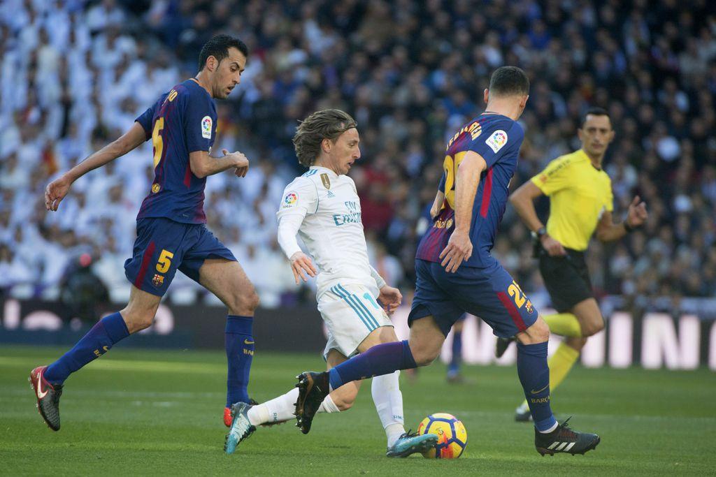 Luka Modrić protiv Barcelone (Foto: AFP)