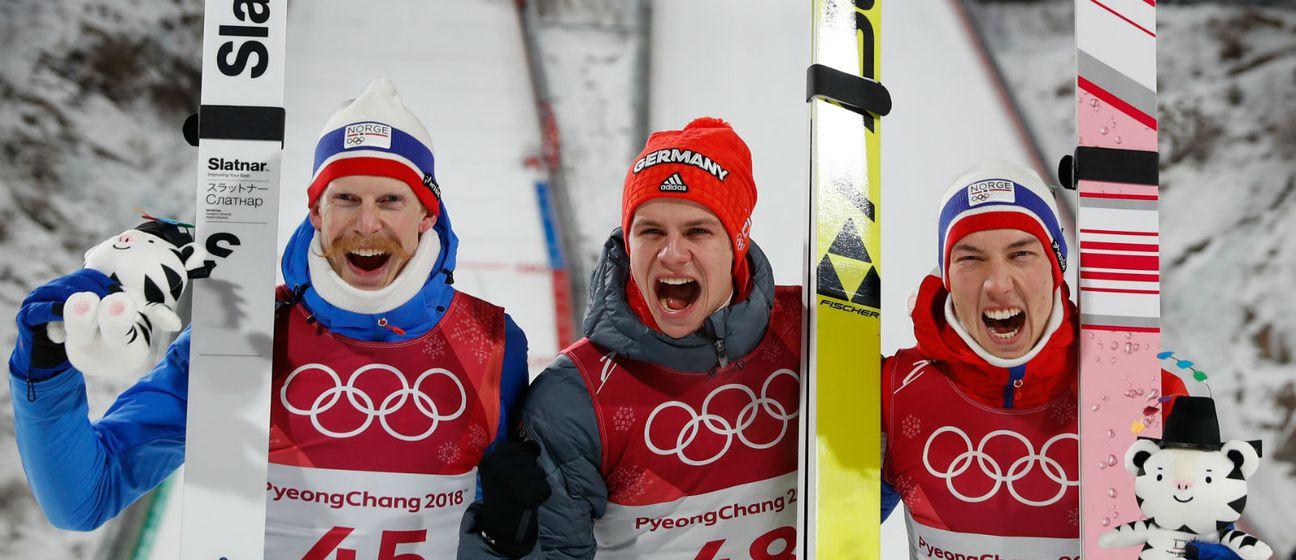 Robert Johansson, Andreas Wellinger i Johann Andre Forfang (Foto: AFP)
