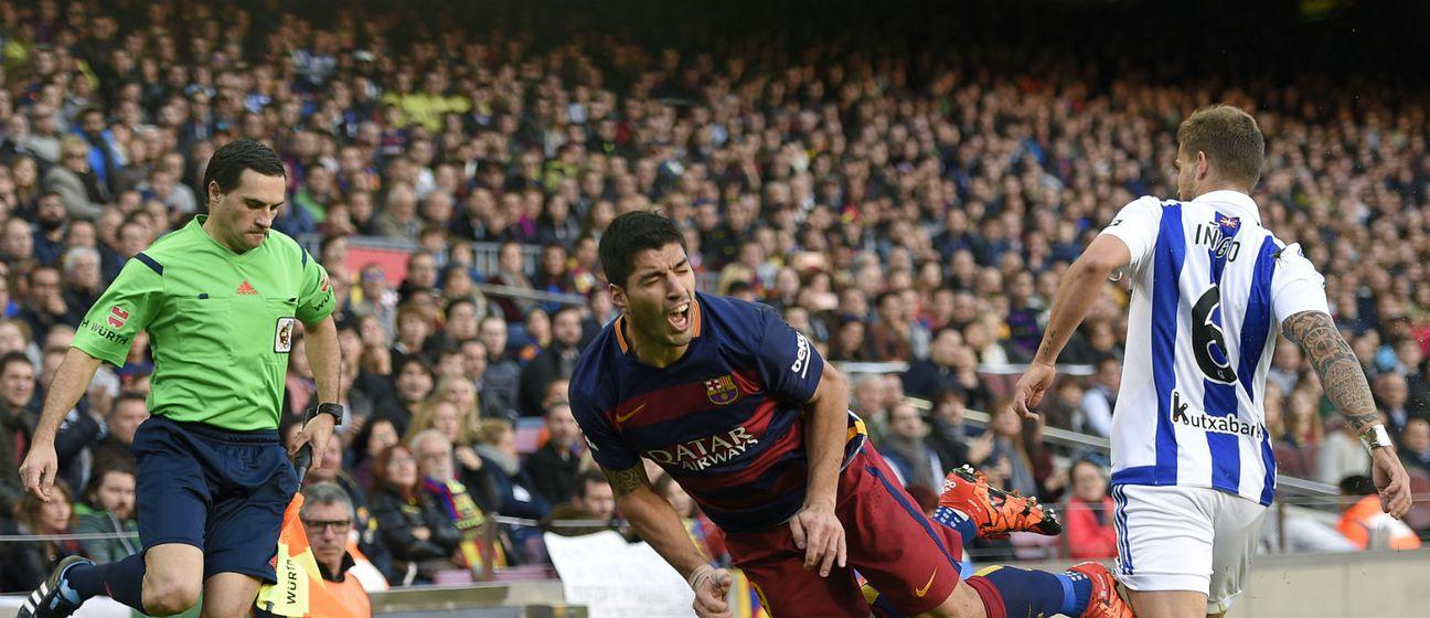 Luis Suarez i Ingo Martinez (Foto; AFP)