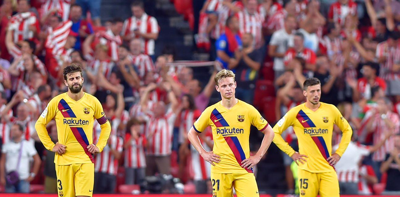 Razočarani igrači Barcelone (Foto: AFP)