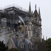 Sanacija požarišta na katedrali Notre Dame (Foto: AFP) - 2