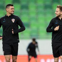 Dejan Lovren i Ivan Rakitić (Foto: Sanjin Strukić/PIXSELL)