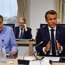 Angela Merkel i Emmanuel Macron (Foto: AFP)
