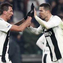 Mario Mandžukić i Cristiano Ronaldo (Foto: AFP)
