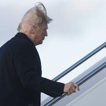 Nema više dvojbe - Trumpova kosa je prava (Foto: AFP)