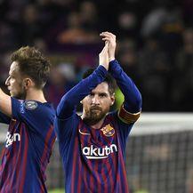Ivan Rakitić i Lionel Messi (Foto: AFP)