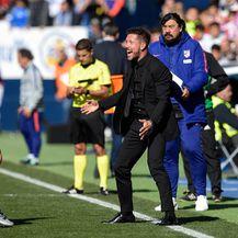 Antoine Griezmann i Diego Simeone (Foto: AFP)