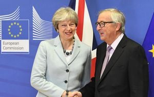 Theresa May i Jean-Claude Juncker (Foto: AFP)