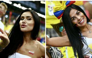 Poljska i kolumbijska navijačica (Foto: AFP)