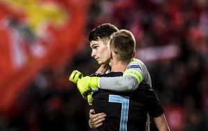 Dominik Livaković i Dani Olmo (Foto: AFP)