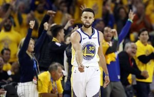 Steph Curry slavi tricu (Foto: AFP)