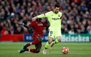 Sadio Mane i Lionel Messi (Foto: Martin Rickett/Press Association/PIXSELL)