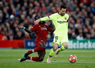 Sadio Mane i Lionel Messi (Foto: Martin Rickett/Press Association/PIXSELL)