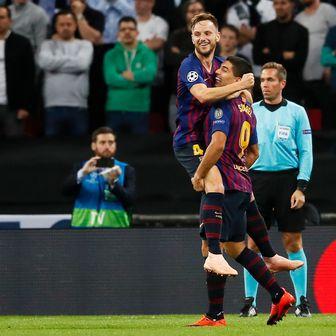 Ivan Rakitić i Luis Suarez (Foto: David Klein/Press Association/PIXSELL)