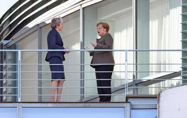 Theresa May i Angela Merkel (Foto: AFP)