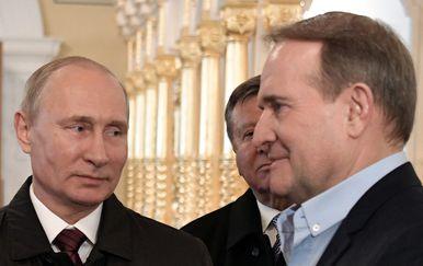 Vladimir Putin i Viktor Medvedčuk (Foto: AFP)