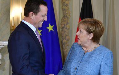 Richard Grenell i Angela Merkel (Foto: AFP)