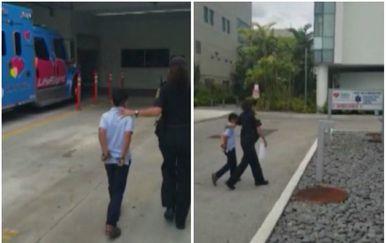 Sedmogodišnjak s lisicama na rukama (Foto: screenshot/APTN)