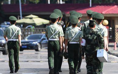 Policija u Pekingu (Foto: AFP)