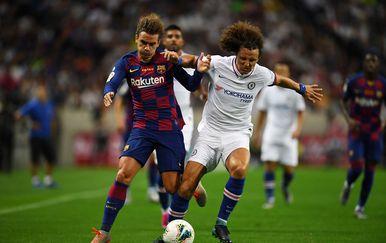 Antoine Griezmann i David Luiz (Foto: AFP)