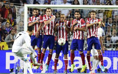 Cristiano Ronaldo u akciji protiv Atletico Madrida (Foto: AFP)