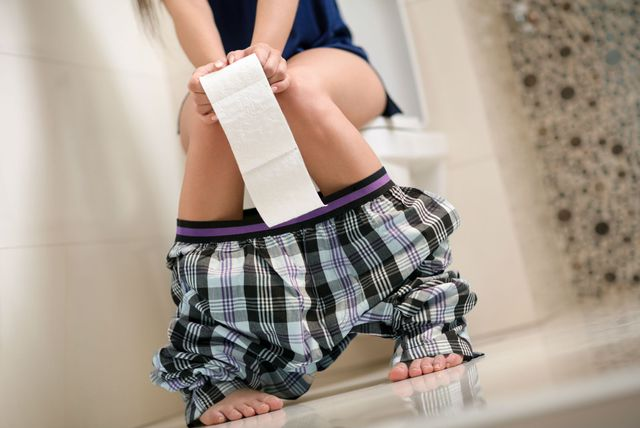 Žena na WC-u