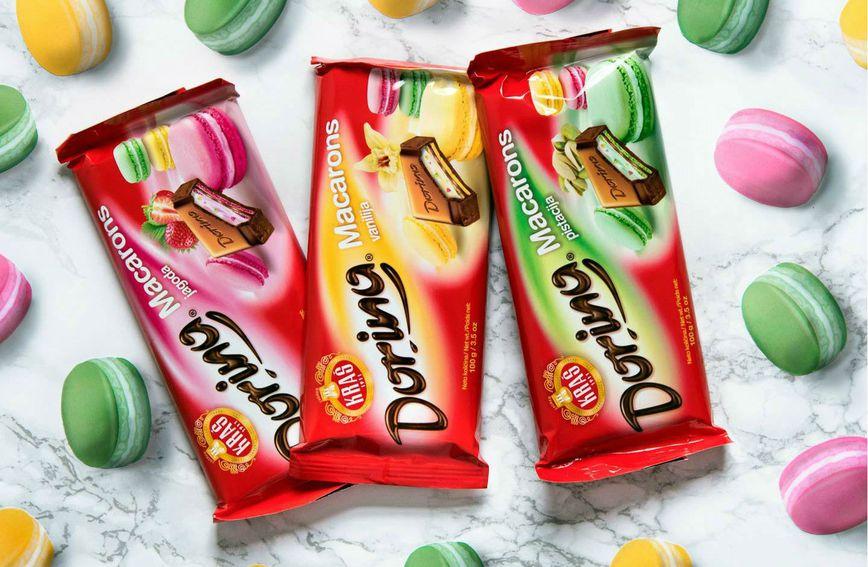 Čokolada Dorina Macarons s okusom vanilije, jagode i pistacije