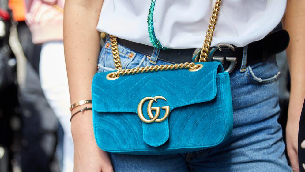 Torba i remen s monogramom modne kuće Gucci
