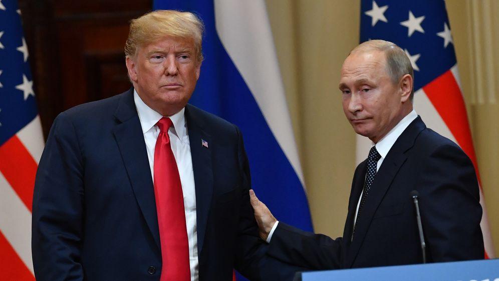 Donald Trump i Vladimir Putin (Foto: Arhiva/AFP)