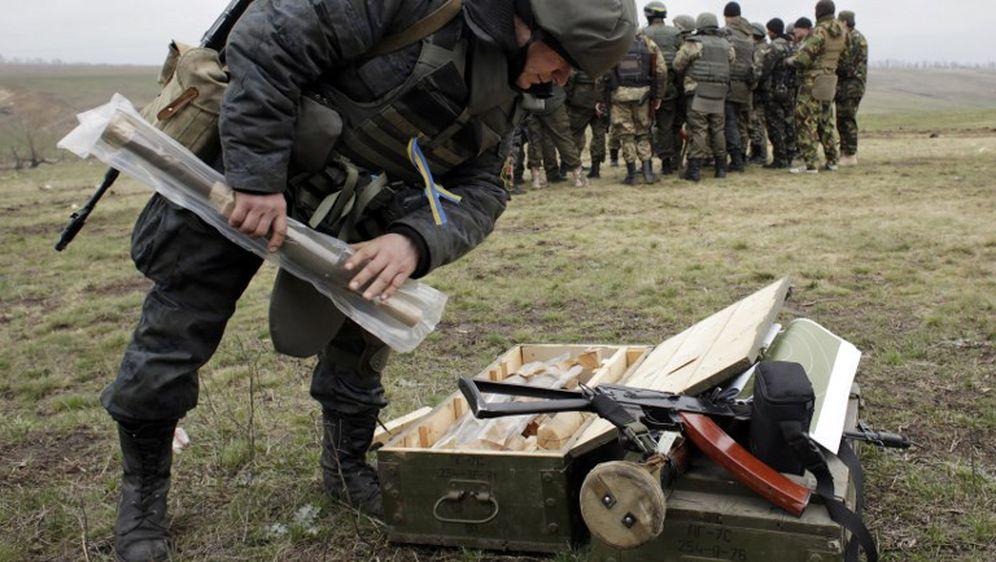 Ukrajinski volonteri na vojnoj vježbi (Foto: AFP)