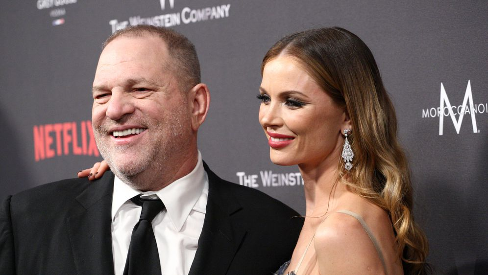 Harvey Weinstein i Georgina Chapman (Foto: AFP)